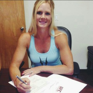 Holly Holm signing her UFC Contract