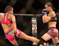 Amanda Nunes vs. Shayna Baszler during UFC Fight Night 62 by Jason Silva-USA TODAY Sports