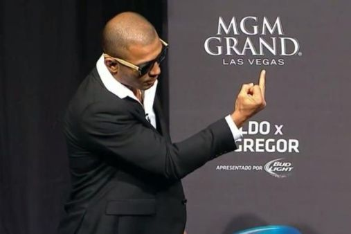 Jose Aldo Jnr Flipping The Bird at Conor McGregor on the UFC 189 world tour press conference