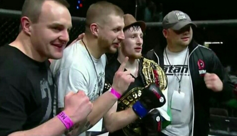 Brett Johns and his Team after winning The Bantamweight Championship Belt at Titan FC 33