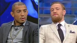 UFC 189 FOX Sports Live split screen picture of Jose Aldo and Conor McGregor